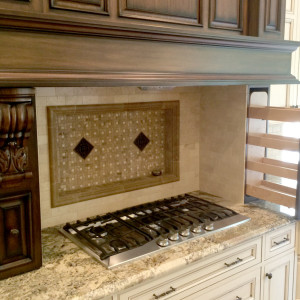 Kitchen Renovations with Carved Wood Vent Hood and Elegant Backsplash Feature in NJ